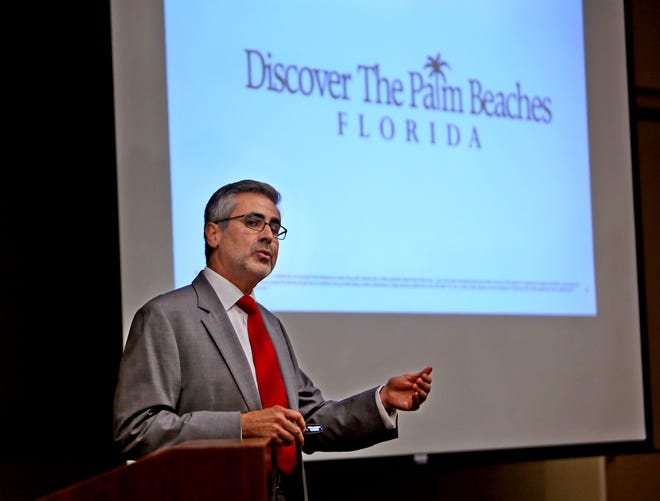 Jorge Pesquera, president and CEO of Discover The Palm Beaches, speaks during a board meeting at the Convention Center in West Palm Beach in September 2013.