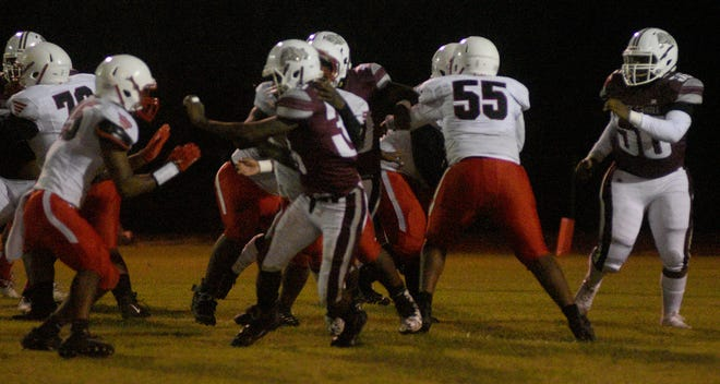White Castle and East Iberville battle in action last Friday in their annual rivalry game. East Iberville gained a measure of revenge with a 28-27 win over the Bulldogs in a classic contest.