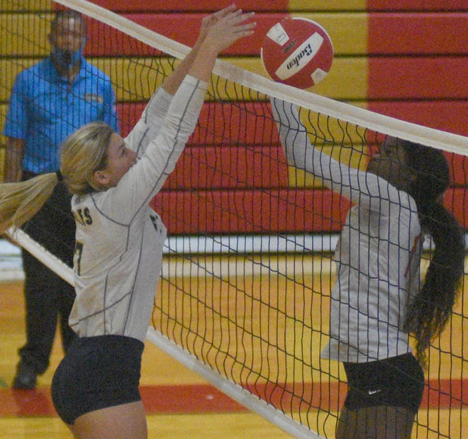St. John's Dannie Durand (7) blocks a shot from East Iberville's Taylor Gordon (11) in recent action. Both teams will landed berths in Division V volleyball playoff action.