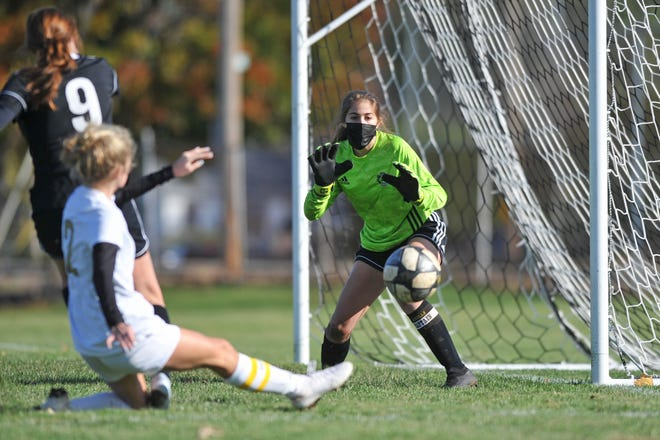 Pilgrim goalkeeper Janelle Mixner prepares for a shot by North Kingstown's Haleigh Ward, which went wide right. Mixner finished with six saves in the match.