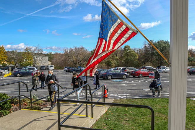 On a breezy and picturesque Election Day, a seeming counterpoint to the stresses of life in a pandemic and a nation divided, voters make their way into Cranston Christian Fellowship church, one of several polling places in the city.