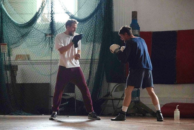 "Lion Kaminski, right, (Jack O'Connell) is a boxer forced by circumstances to fight underground in bare-knuckle bouts with his big brother Stan (Charlie Hunnam) as his cornerman in ""Jungleland,"" which was filmed in and around Fall River."