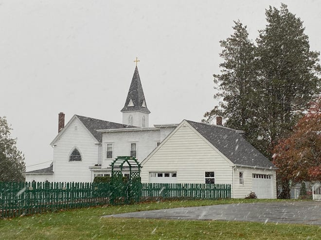 Snow falls Tuesday morning near St. Ambrose Church in Lincoln. (The Providence Journal / Michael Delaney)