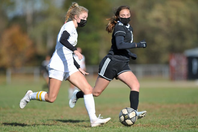 North Kingstown's Haleigh Ward, left, has found soccer to be her refuge from spina bifida, even the sport adds to her daily pain.