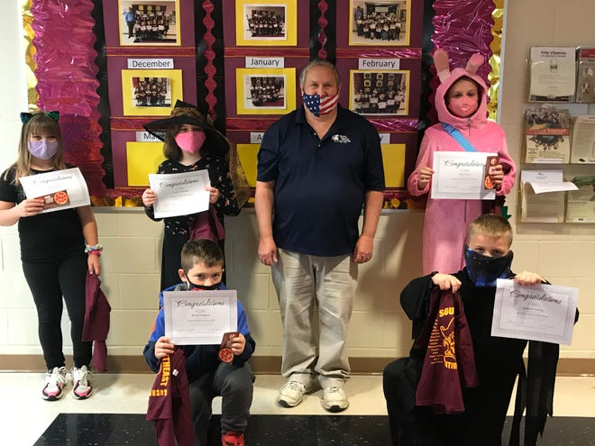 Southeast Intermediate School recently named Positive Pirates for October. Front Row from left are Kayden England and Anthony Cutting. Back Row from left are Gabby Christie, Lucy Lauderdale, Lion's Club president Roger Mansfield and Alivia Coss.  Also honored was Kendall Shamblin.
