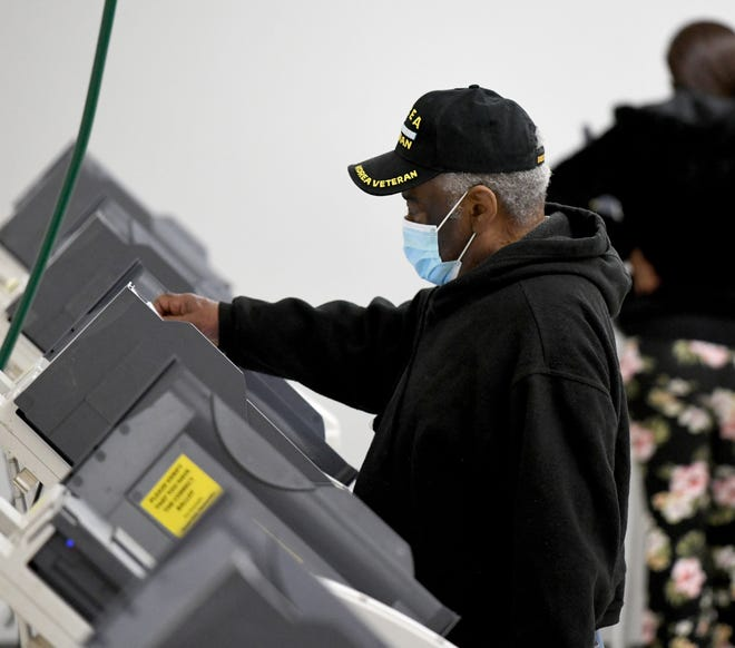 "James Griffin of Canton votes Tuesday at the Edward ""Peel"" Coleman Community Center in Canton."
