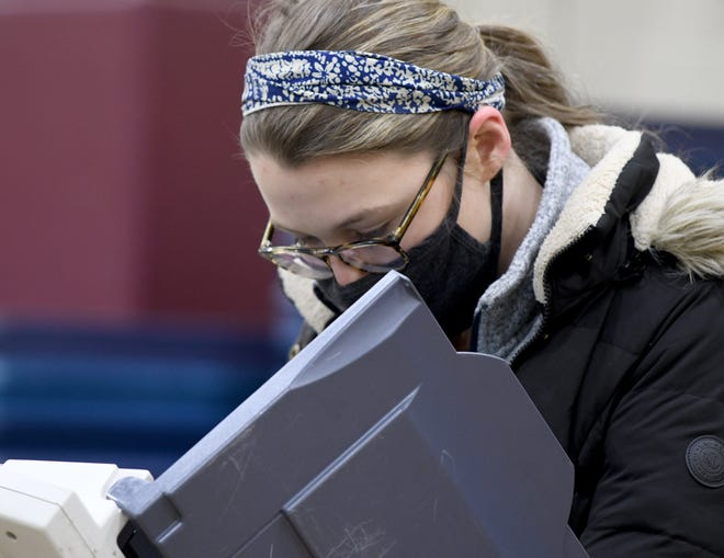 Voter Shannon Lagrou casts her vote at the North Canton Church of Christ  polling location in the 2020 General Election.  Tuesday, November 03, 2020.