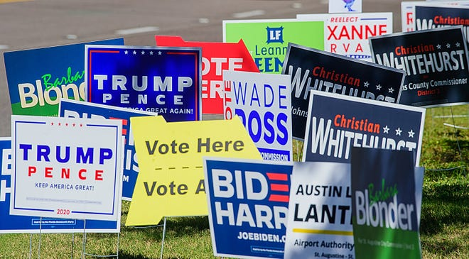 Political signs sit on the sit of Anastasia Boulevard in front of the polling station in the Elks Lodge in St. Augustine on Tuesday, Nov. 3, 2020.