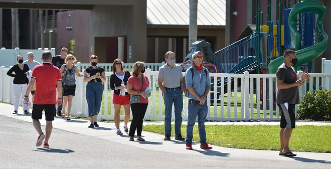 Voters wait in line Tuesday, Nov. 3, 2020, at the Sarasota Baptist Church.