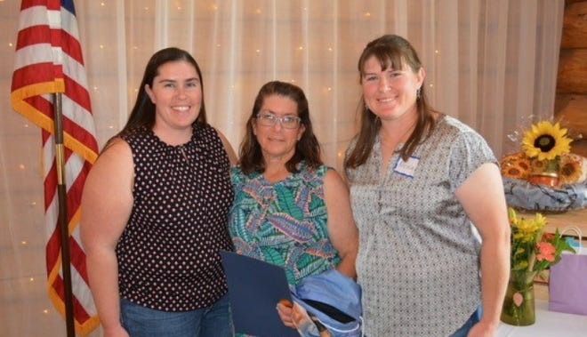 2020 Siskiyou CattleWoman of the Year Caroline Luiz, center, is congratulated by her daughters Keri Luiz-Daniels, left and Nicole Stevens following the surprise award announcement at the 65th anniversary meeting of the Siskiyou CattleWomen in early October.