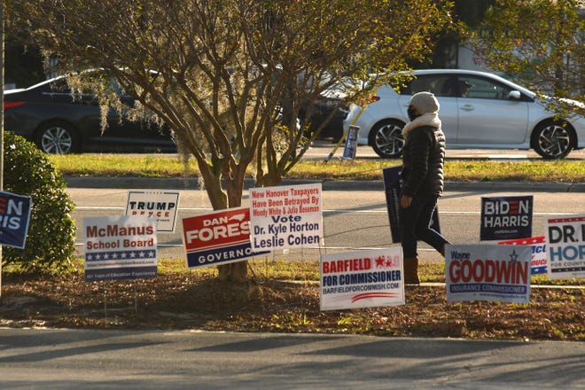 Poll workers and voters were out Tuesday at the New Hanover County Senior Resource Center casting ballots and helping voters. [KEN BLEVINS/STARNEWS]