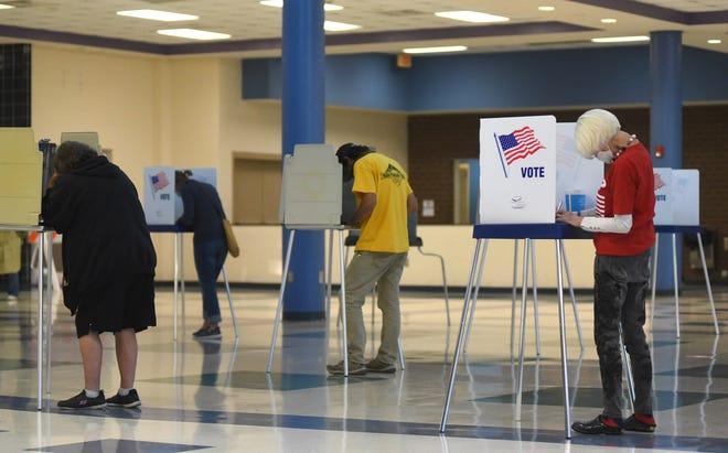 People vote at Ashley High School in Wilmington, N.C., Tuesday Nov. 3, 2020. Voting closes at 7:30 p.m. in North Carolina.   [MATT BORN/STARNEWS]