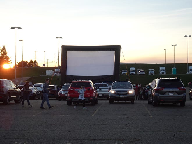 A 70-foot inflatable movie screen was set up in the offsite parking lot of the Akron-Canton Airport on Oct. 17 where over a hundred families parked to watch a movie drive-in theatre style.