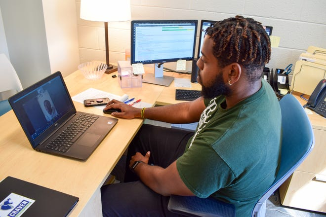 Austin Dixon, Career & College Promise (CCP) program advisor, speaks with a student during a virtual meeting. The CCP program recently received a $1,000 grant from the International Paper Foundation. [CONTRIBUTED PHOTO]