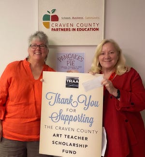 Partners In Education was recently awarded $2,000 from Twin Rivers Artists Association to be used for grant money for art teachers in Craven County Schools.  The grants are awarded to art teachers based on imaginative and creative art programs for their students.  Pictured are (left to right) Patricia Eglinton with Twin Rivers Artists Association and Darlene Brown, executive director, Partners In Education.  To learn more about TRAA, visit traa.wildapricot.org, and to learn more about PIE, visit cravenpartner.com. [CONTRIBUTED PHOTO]