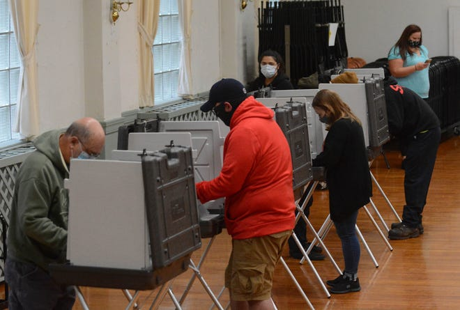 Voters cast ballots in eastern Connecticut on election day in November.