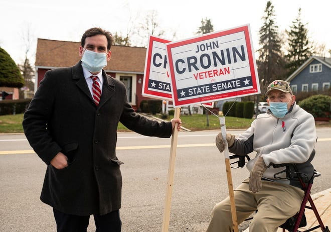 John Cronin, candidate for state Senate, greets his grandfather Joseph Cronin outside TC Passios Elementary School on Tuesday.