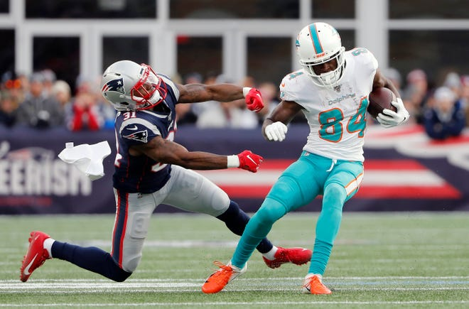 During the final game of the 2019 regular season, Dolphins wide receiver Isaiah Ford (84) escapes from Patriots cornerback Jonathan Jones. Ford is now on his way to New England.