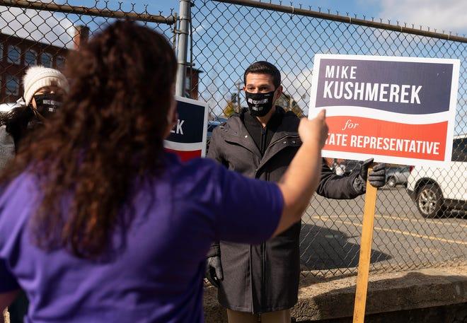 FITCHBURG - Michael Kushmerek campaigns outside St. Joseph's Catholic Church on Tuesday.