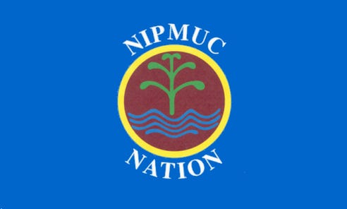 The Nipmuc Nation flag shows a cornstalk and water against a brown background representing the Earth, within a yellow circle representing the sun.
