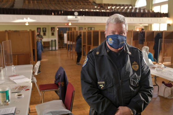 Spencer Police Chief David B. Darrin, shown Tuesday at Spencer Town Hall, has observed elections in foreign countries.