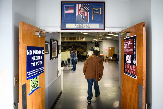 A voter enters the polling site at VFW Post 6018 on Tuesday.