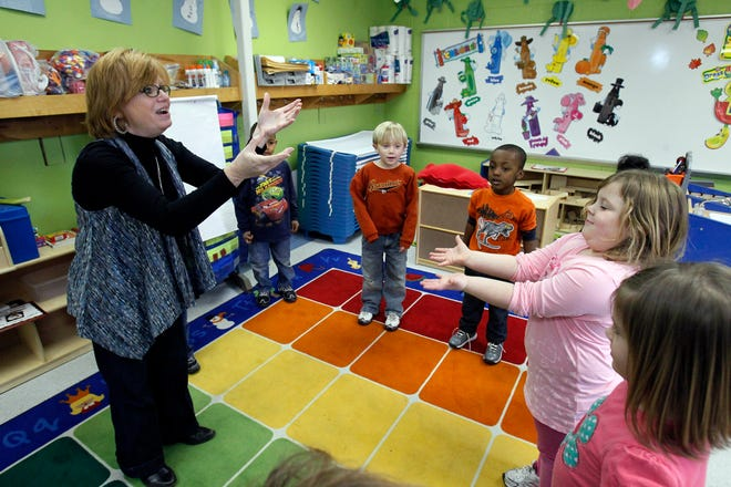 A teacher and and her pre-K students play a color game as part of an early learning initiative in Mississippi focusing on the development of children from birth until age 5 with a wide variety of programs.