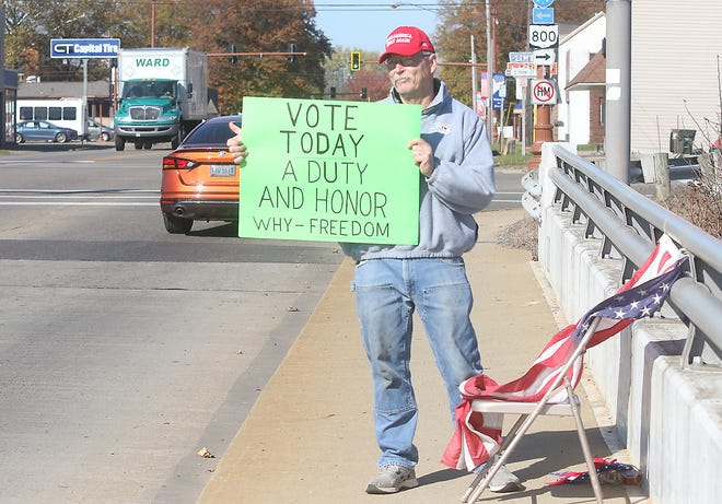 John Freshwater of Dover was out on the bridge  on Wooster Avenue in Dover urging people to get out and vote Tuesday.