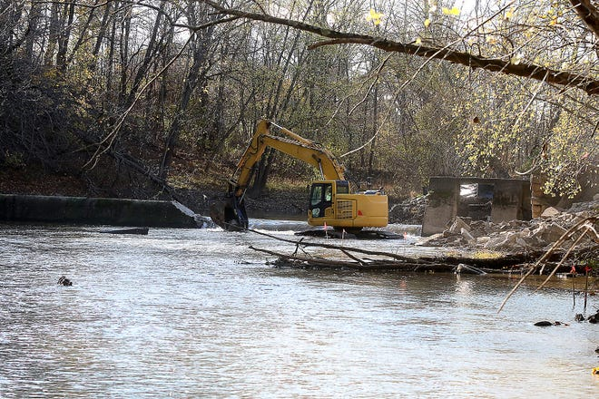 Demolition crews were clearing rocks near the lowhead dam in Uhrichsville on Monday and Tuesday. Demolition of the dam on the Stillwater Creek will take place this week.
