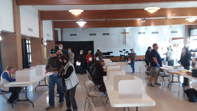 Citizens exercise their right to vote at the First United Methodist Church in Dover on Tuesday.