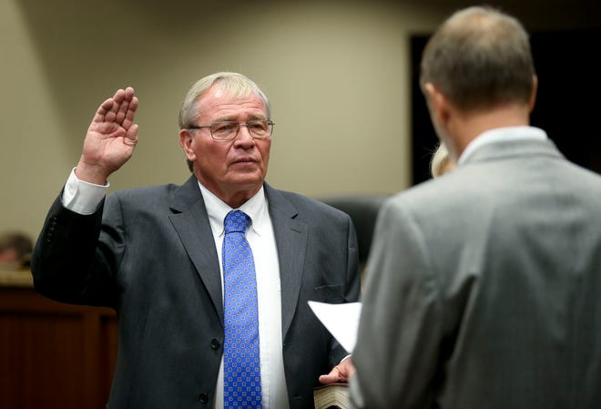 The new Northport mayor and city council were sworn in to office Monday night in the city council chambers at Northport Municipal Center. Bobby Herndon is sworn in as mayor by Scott Collins. [Staff Photo/Gary Cosby Jr.]