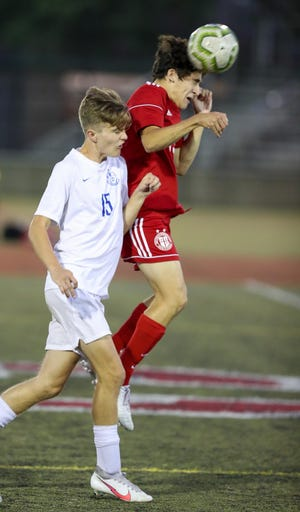 Junior forward Kellen Karas, right, is among the top players expected to return for the St. Charles soccer team. The Cardinals finished 13-4-2 and won their third consecutive CCL championship.