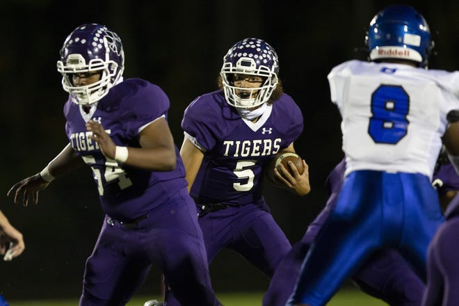 Pickerington Central quarterback Garner Wallace gets a block from offensive lineman Cameron Griffith against Hilliard Bradley on Oct. 23. The Tigers face Mentor in a Division I state semifinal Friday, Nov. 6, at New Philadelphia.