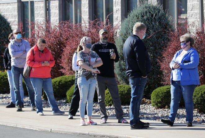 Citizens wait in line to vote Tuesday, Nov. 3, 2020, at Shepherd of the Hills Lutheran Church in Greenville, Wis.