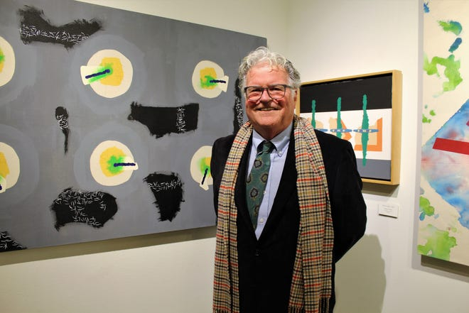 CCAN juror and Fort Worth artist Thomas Motley, his tie askew despite prior straightening by his wife, Rebecca, with his own art on exhibit at The Center for Contemporary Arts downtown.