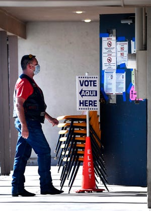 A man enters the polling place at the South 11th Street Church of Christ on Tuesday, Election Day. There were lines at voting centers early Tuesday but those lessened by late morning.