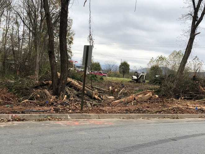A new water tank and pumping station required the removal of trees at the front of the Southchase neighborhood on Hendersonville Road in Fletcher.