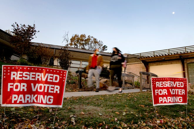 Voters leave their polling place in Asheville after casting ballots on Nov. 3, 2020.