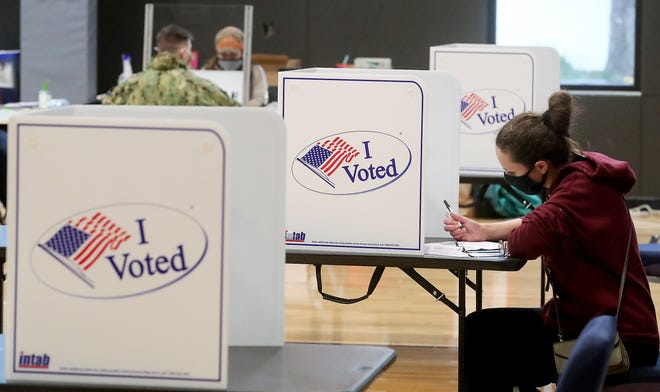 FILE — Lindsay Barker, of Bremerton, casts her ballot at the Marvin Williams Recreation Center in Bremerton on Nov. 3, 2020.