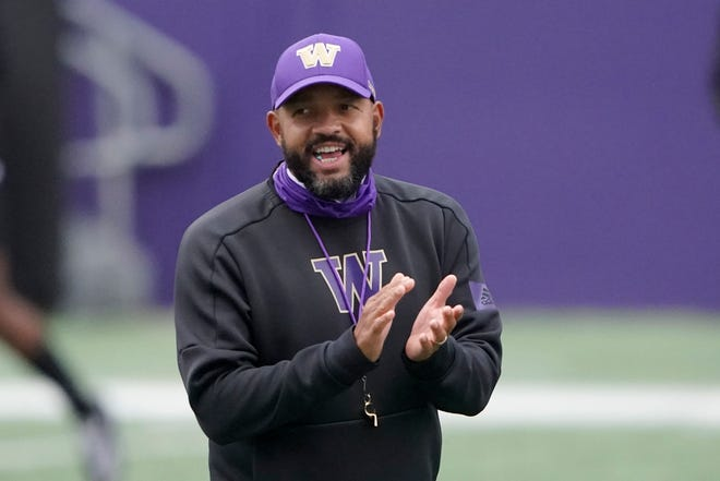 Washington head coach Jimmy Lake calls to his team during NCAA college football practice, Friday, Oct. 16, 2020, in Seattle.