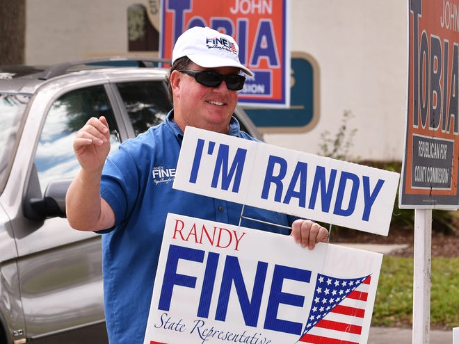 Election Day scenes in West Melbourne, the Veterans Center is always a busy place on Election Day, Randy Fine was out waving at voters.