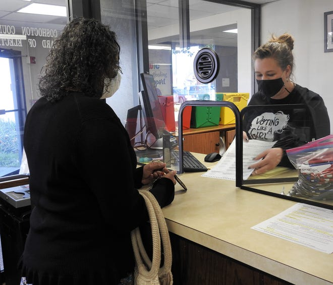 Erika Miller of Coshocton receives instruction from Kirsten Ross, Deputy Director of the Coshocton County Board of Elections, on filling out a provisional ballot on Election Day.