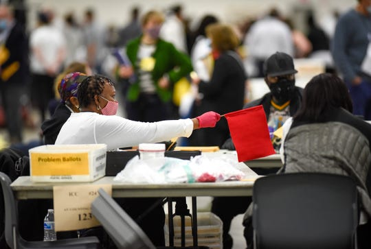 A defiant flag is raised when Detroit's absentee ballots are processed at the TCF Center, Tuesday, November 3, 2020.