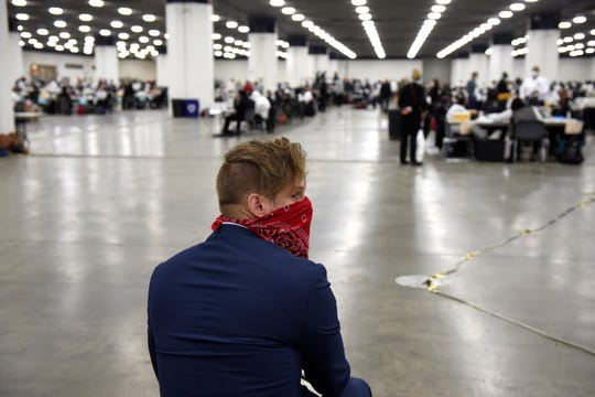 Election watcher Tim Griffin, Virginia, watches as the absentee ballots in Detroit are processed at the TCF Center, Tuesday, November 3, 2020.
