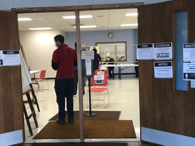 Five people waiting in line to vote while several others cast ballots at Liberty Grove Town Hall on Election Day, Nov. 3.