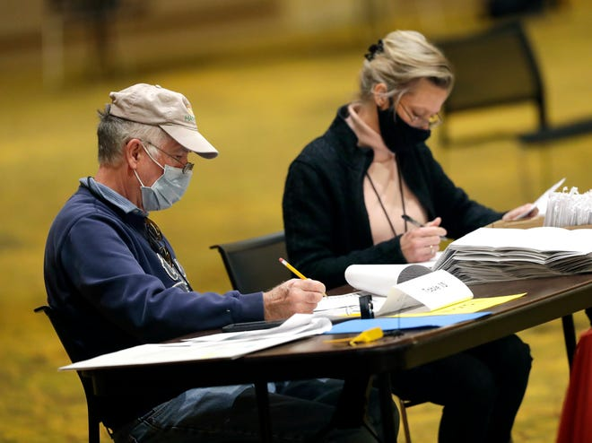 Election workers perform duties at the Central Count location for the city of Green Bay on Nov. 3, 2020.