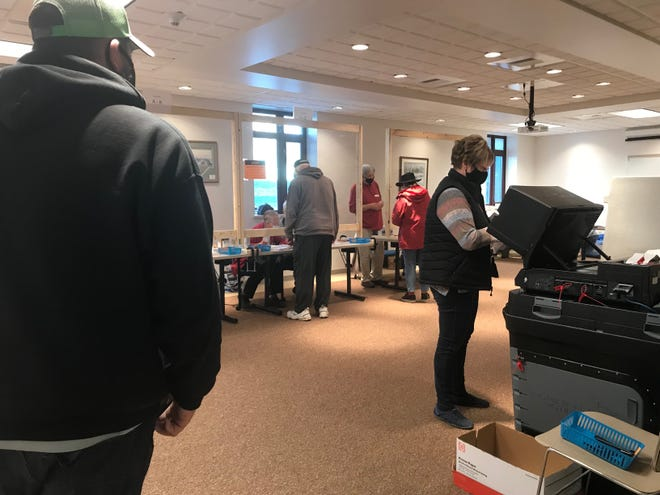 Voters line up in Sturgeon Bay's City Hall, waiting to cast their votes in the 2020 fall election.