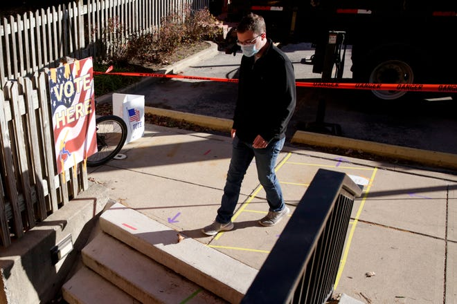 A voter walks into the St. Thomas Aquinas Catholic Center polling location, Tuesday, Nov. 3, 2020 in West Lafayette.