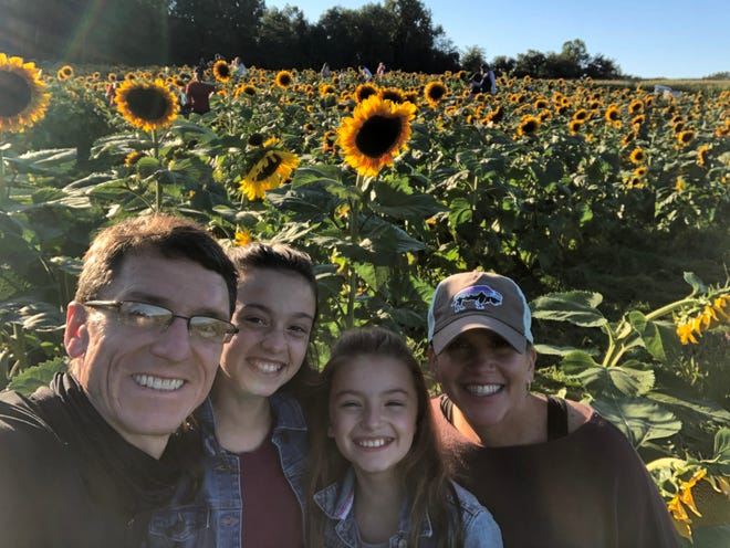 TJ Hofmann (right) is a STEM Lab teacher at Tully Elementary School in Louisville who went through treatment for breast cancer over the past year. She is pictured with her two daughters and husband on one of many nature walks that they have taken in recent months. The family would also make videos of their adventures that Hofmann would then share with her students to keep them engaged and motivated during remote learning.