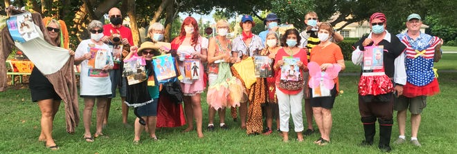 Kiwanis members with donated costumes.